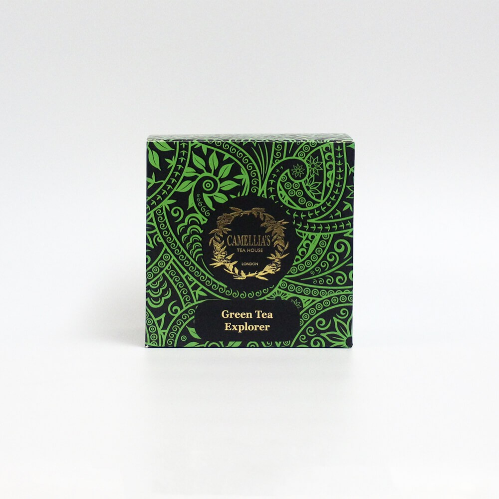 Box of loose leaf tea with a green pattern